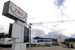 Brazil meat-packing giant JBS agrees to pay record $3