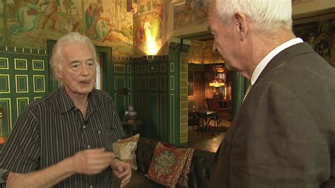 Basement battle: Jimmy Page and Robbie Williams planning
